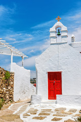 Typical white chapel with red door in Mykonos