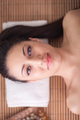 beautiful woman in spa salon relaxing