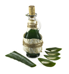 Old green bottle with aloe vera pieces