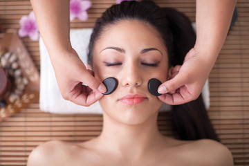 Beautiful woman having a wellness facial massage