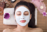 Fototapety Spa therapy for young woman having facial mask at beauty salon