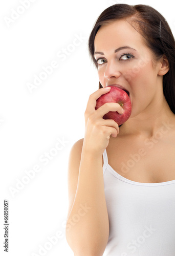 Young woman eating red apple diet time