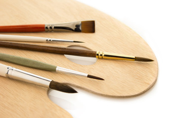 Brushes on natural wooden palette