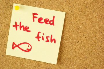 Feed the fish remind sticker on cork