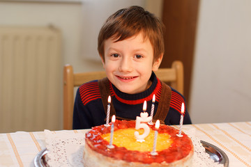 Happy little kid with birthday cake