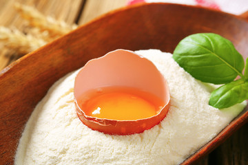 Flour and fresh egg in a scoop