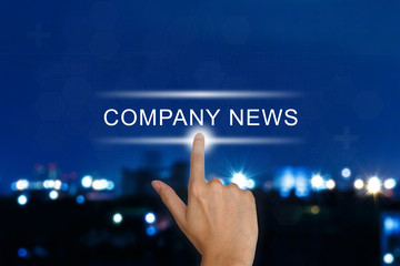 hand pushing company news button on touch screen