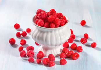 Ripe raspberries on a wooden background