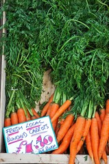 Carrots with green tops © Arena Photo UK