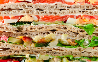 sandwich with salmon and vegetables