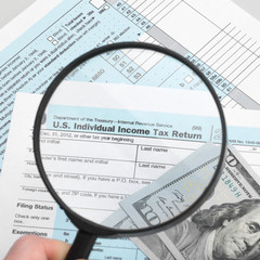 US Tax Form 1040 with magnifying glass - 1 to 1 ratio