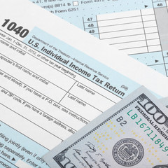 US Tax Form 1040 with two 100 dollars bank - 1 to 1 ratio