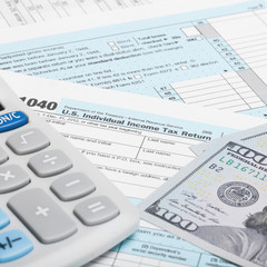 US Tax Form 1040 with calculator and US do - 1 to 1 ratio