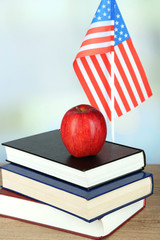 Composition of  American flag, books and apple