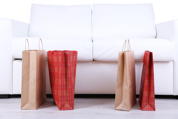 Bags of shopping on sofa background close-up