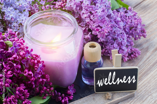 Fotobehang Lilac fresh lilac flowers spa setting