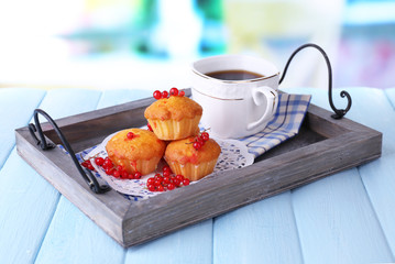 Tasty muffin with red currant berries