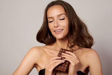 Girl with chocolate are dieting, healthy and organic foods