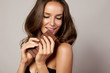Portrait of girl holding a chocolate bar feeling temptation