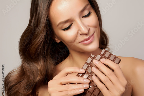 Beautiful girl with chocolate healthy eating and organic foods