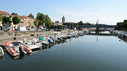 The water channel with parked motor boats, Rimini, Italy