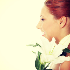 Attractive girl with lily flower in hand