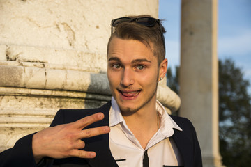 Blond young man with cute, funny expression