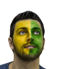 Brazilian fan painted in yellow and green isolated