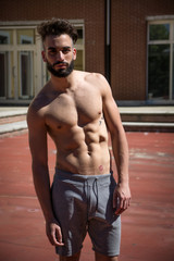 Handsome shirtless young man with beard