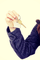 Young businesswoman with house keys in hand