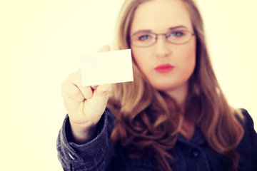 Businesswoman holding blank empty businesscard