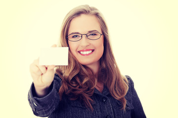 Businesswoman holding blank empty business card.
