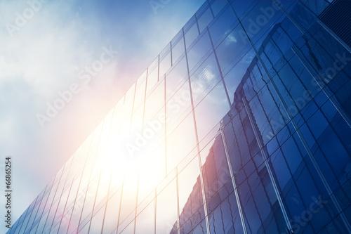 blue glass wall of skyscraper