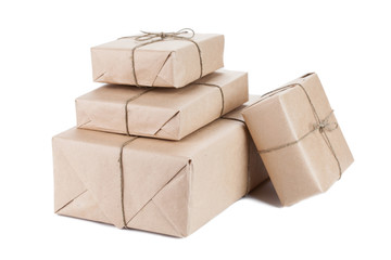 Boxes wrapped with brown kraft paper isolated on white backgroun
