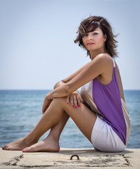 Italy, Sicily, beautiful girl portrait by the sea