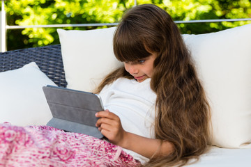 Young girl using tablet
