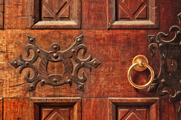 Wooden door with golden handle.