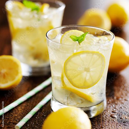 two glasses of lemonade shot close up