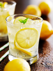 two glasses of lemonade shot close up