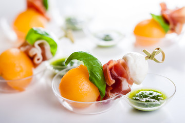 melon,mozzarella and prosciutto on skewers