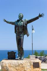 Italy, Apulia, Polignano a Mare, Domenico Modugno statue.
