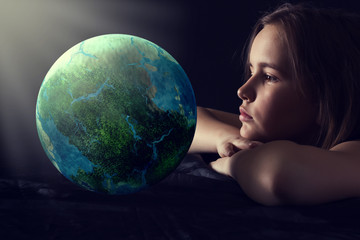 Teen girl with planet earth.