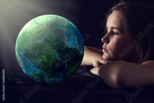 Leinwanddruck Bild Teen girl with planet earth.