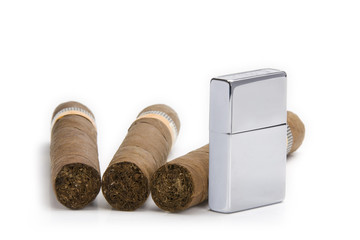 lighter and three cigars on white background