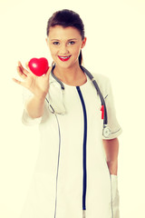 Young female doctor with heart