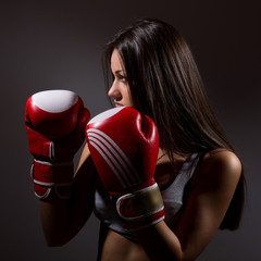 Beautiful woman with the boxing gloves,dark