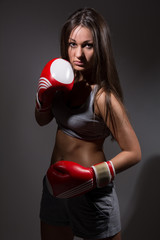 Girl with boxing gloves in front.