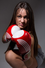 Girl with boxing gloves, dark hair.