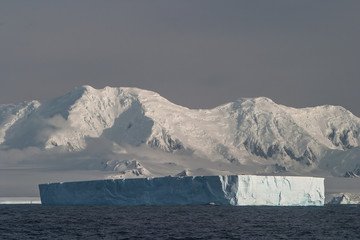 Iceberg and Antarctic Mountains