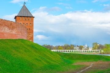 Kremlin tower and the view of YaroslavDvorische. Veliky Novgorod